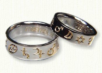 14kt white gold with 18kt gold electroplate Custom Astrological Wedding Rings. This couple had us create their astrology wedding rings depicting the alignment of the planets on the day they were married.