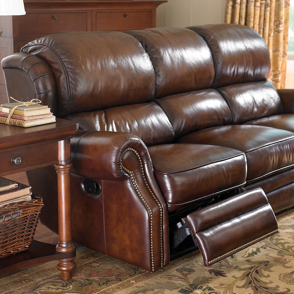 The Leather Newbury Motion Sofa by Bassett Furniture features