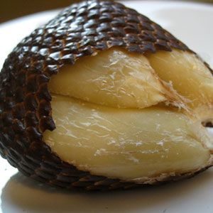 Salak  Salak, or snake fruit, as they are also called, are native to Indonesia, Malaysia, and Brunei. The small individual fruits are covered in a scaly skin that looks disturbingly similar to a snake. Once peeled, the inner lobes are sweet and acidic and their texture is similar to an apple.
