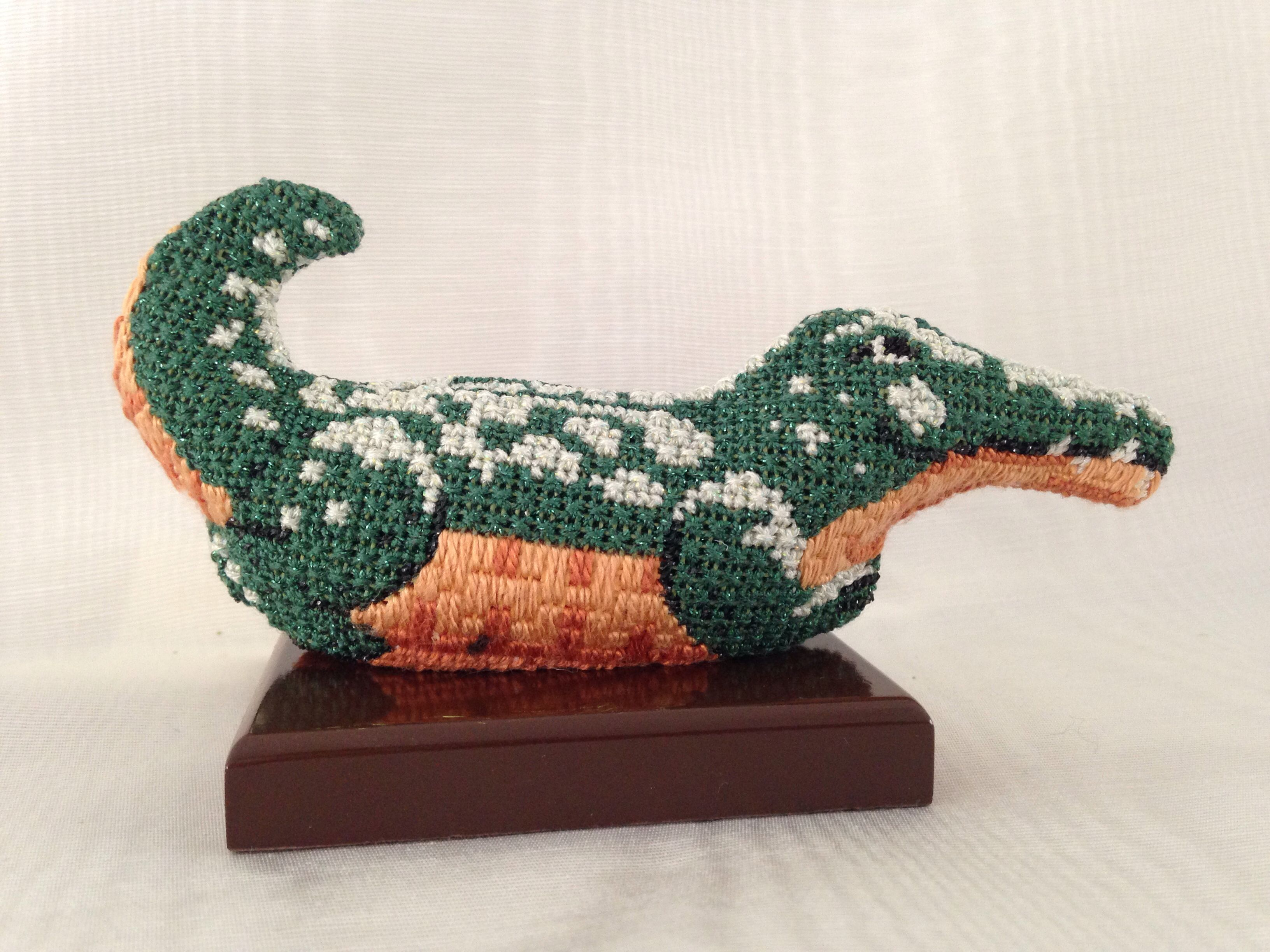 Free standing two-sided needlepoint alligator.