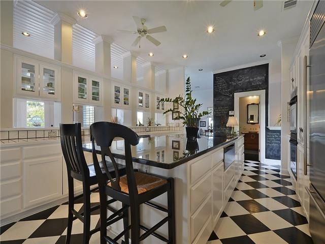Beau Checkered Tile Floor And Chalkboard Wall At 501 East Ave, Marble Falls TX  #kitchens #austinrealestate #homedecor