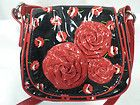 a black with red flowers bag