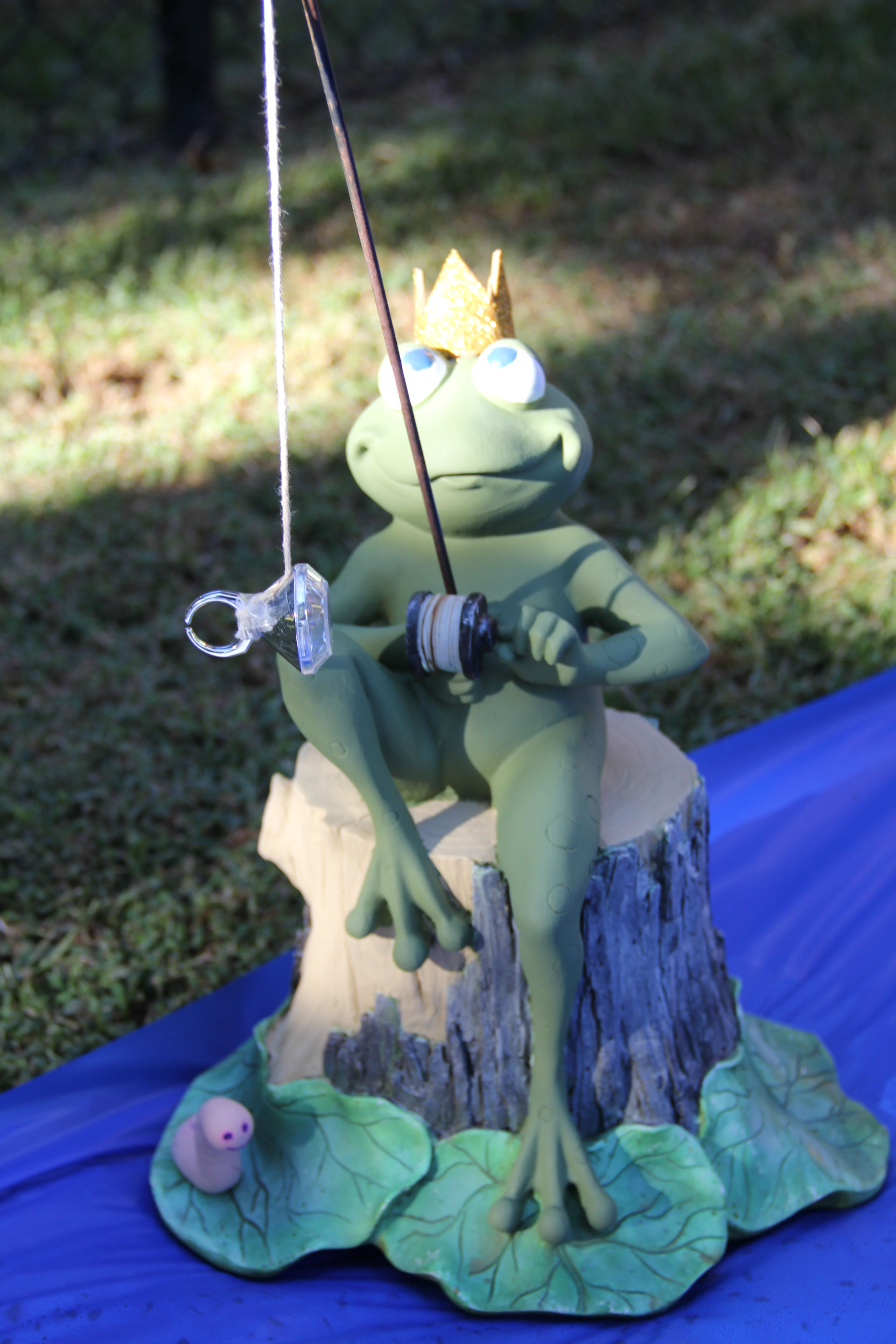 """Decoration Ideas for a Princess Party.  This is just a garden statue that I already had - I just added a """"play"""" ring, a crown made out of a glittery gold craft foam sheet and a little smiling worm (happy because he isn't on the hook!) made out of Crayola Model Magic Clay."""
