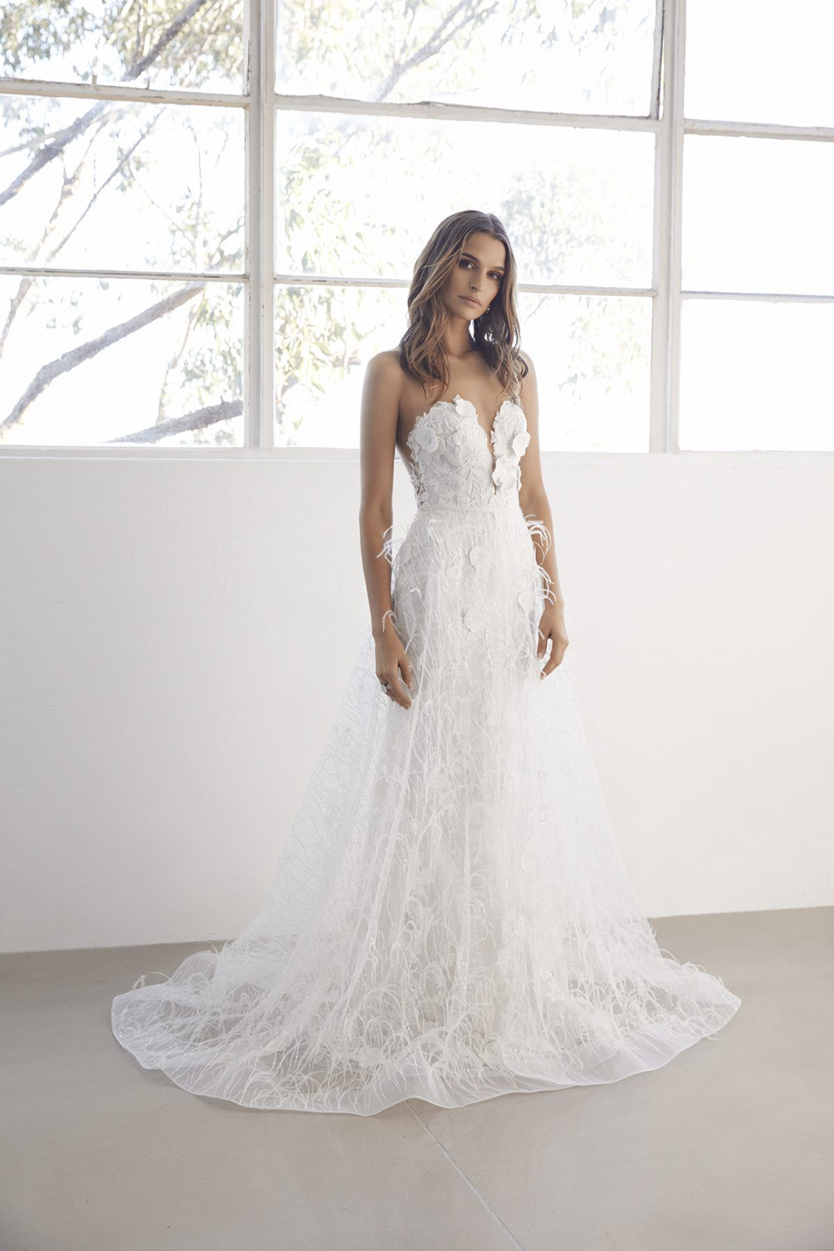 Strapless sweetheart fit and flare wedding dress with detachable