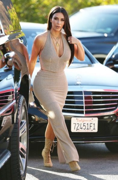 SEPTEMBER 23, 2016  Here's Kim K attending a wedding in Simi Valley, California. Plunging neckline, of course.
