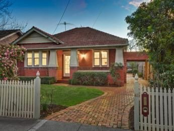 Brick Californian Bungalow House Exterior With Picket Fence Hedging