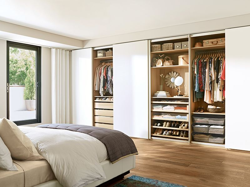Picking your outfit from bed is within reach with pax for Bedroom ideas with built in wardrobes