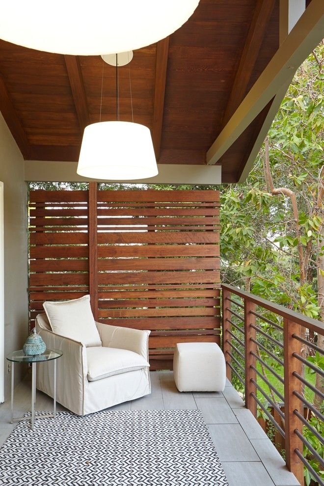 small balcony with wood rail, high wood slat on one side