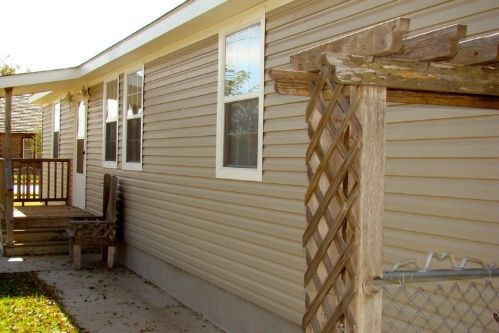Vinyl Coated Seamless Steel Siding Systems Combine Both