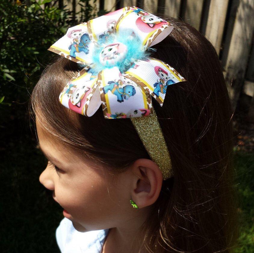 Sheriff Callie's Wild West Glitter Headband or Bow READY TO SHIP by BerryBlondeRibbon on Etsy https://www.etsy.com/listing/229240725/sheriff-callies-wild-west-glitter