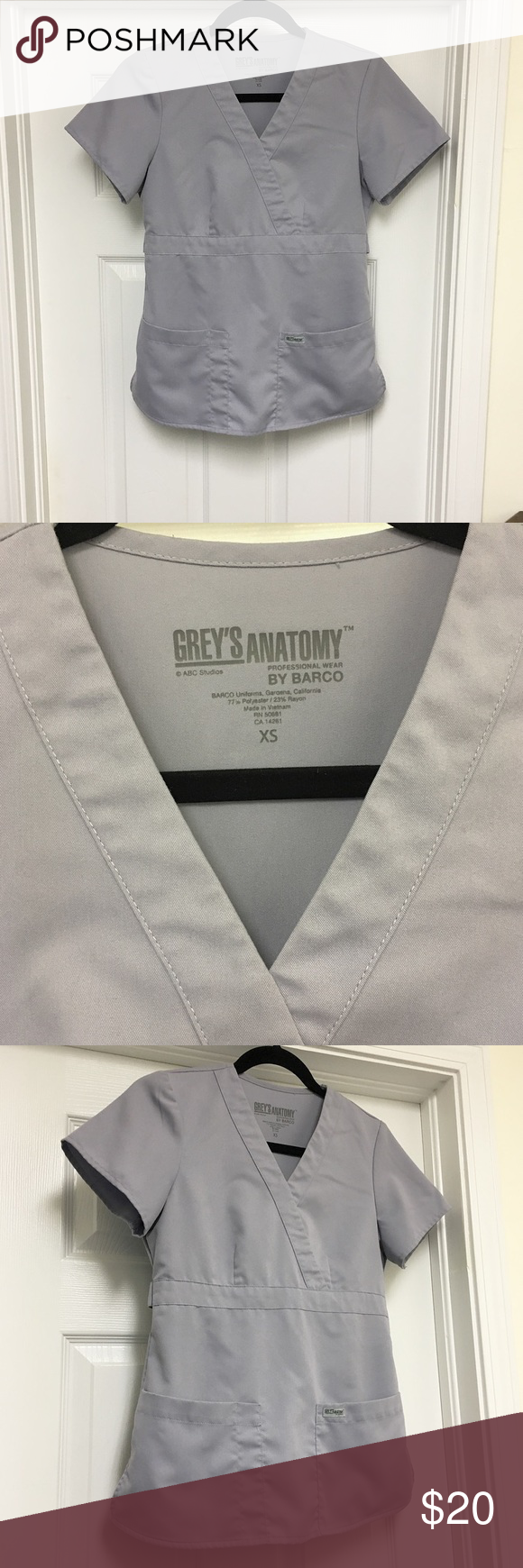 """Moonstruck Grey's Anatomy Scrub Top Light grey/silver scrub top by Barco's Grey's Anatomy scrub line. Size XS. Mock wrap style top. Two adjustable buttons for tightening or loosening around waist. Has two front pockets. Soft and comfortable polyester/rayon blend. Not stretchy material. Runs SMALL. Color is called """"Moonstruck"""" worn once and in pristine condition Grey's Anatomy Tops Tees - Short Sleeve"""