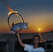 Dominique the Cat Man performs during the nightly Sunset Celebration