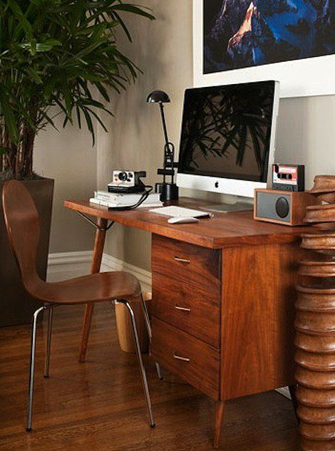 For an eclectic office with unique pieces, head to your local flea market or salvage yard. Chances are you'll be able to score a unique desk and chair without breaking the bank.   Source: Green Couch
