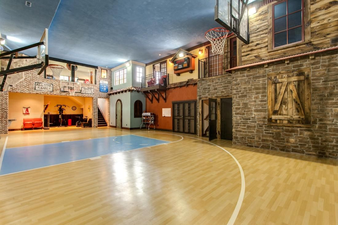 Basketball court with a two story rockclimbing wall for Basketball hoop inside garage