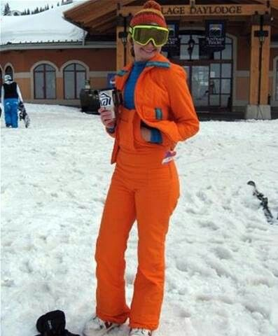 A harkening back to the 1970's: A Woman's Giants Orange 2-Piece Ski Suit