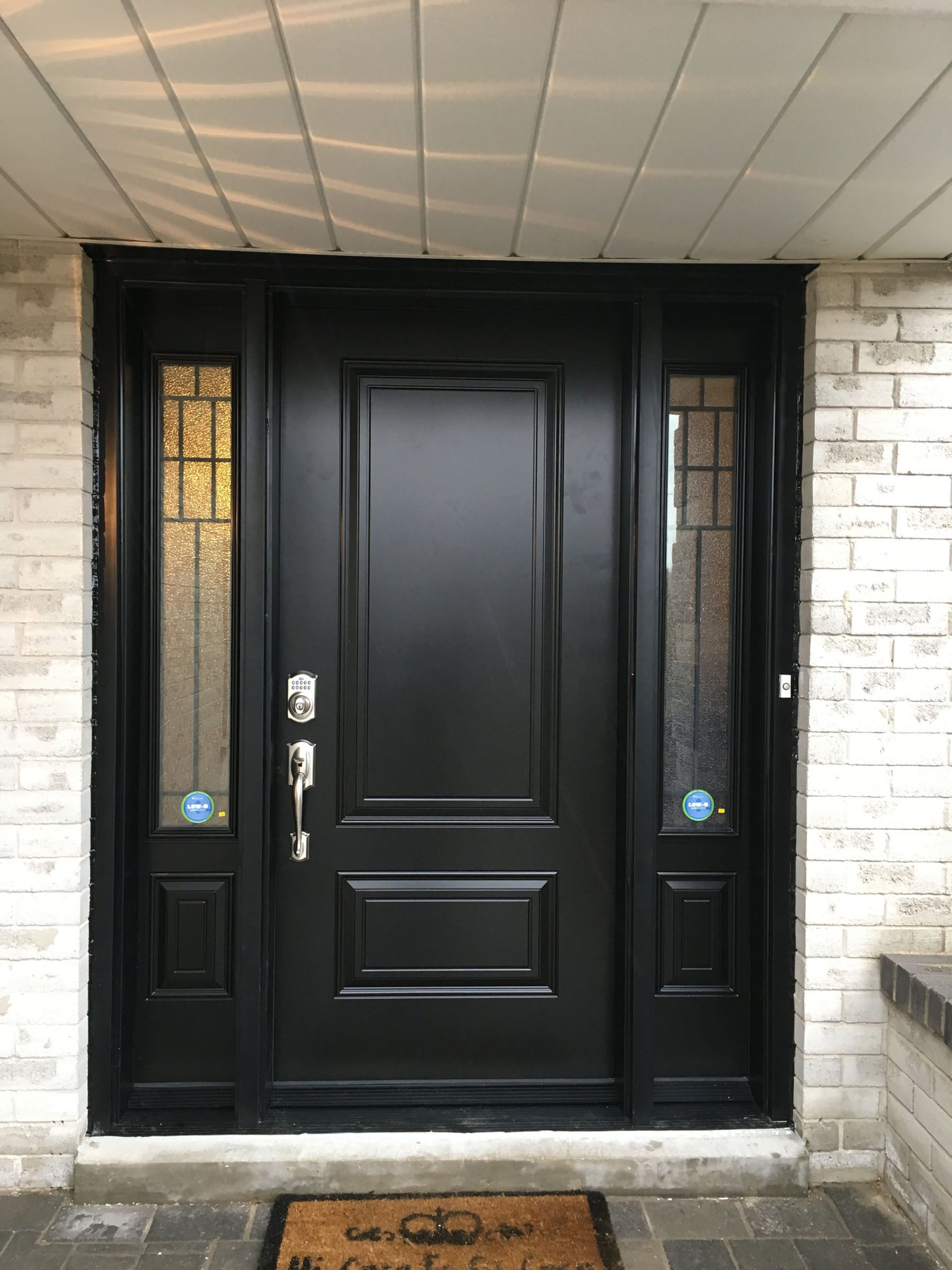 A Brand New Modern Style Entry Door Installation With Custom