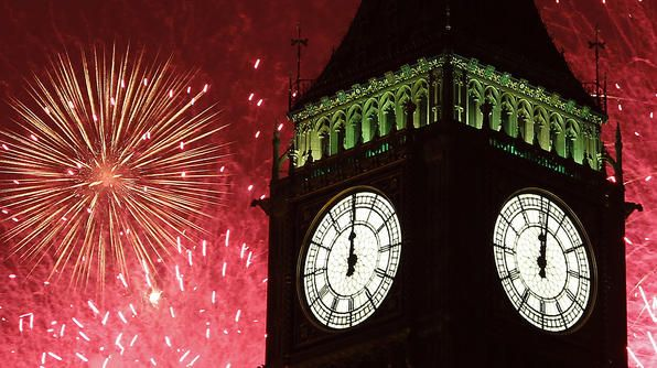 Fireworks explode behind The Big Ben clock tower during New Year celebrations in London.