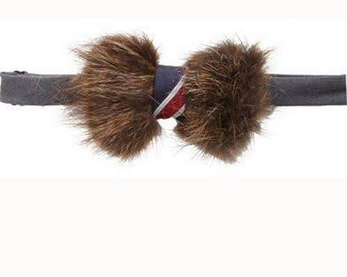 The Vanity Bow Tie in Beaver: A tuft of fur plucked from the pelt of a French beaver and wrapped in a regimental striped ribbon. We all know there's nothing the dapper man likes more than a dead beaver in his face, but this $169 beaver bow tie from Barney's New York is just damn awful.