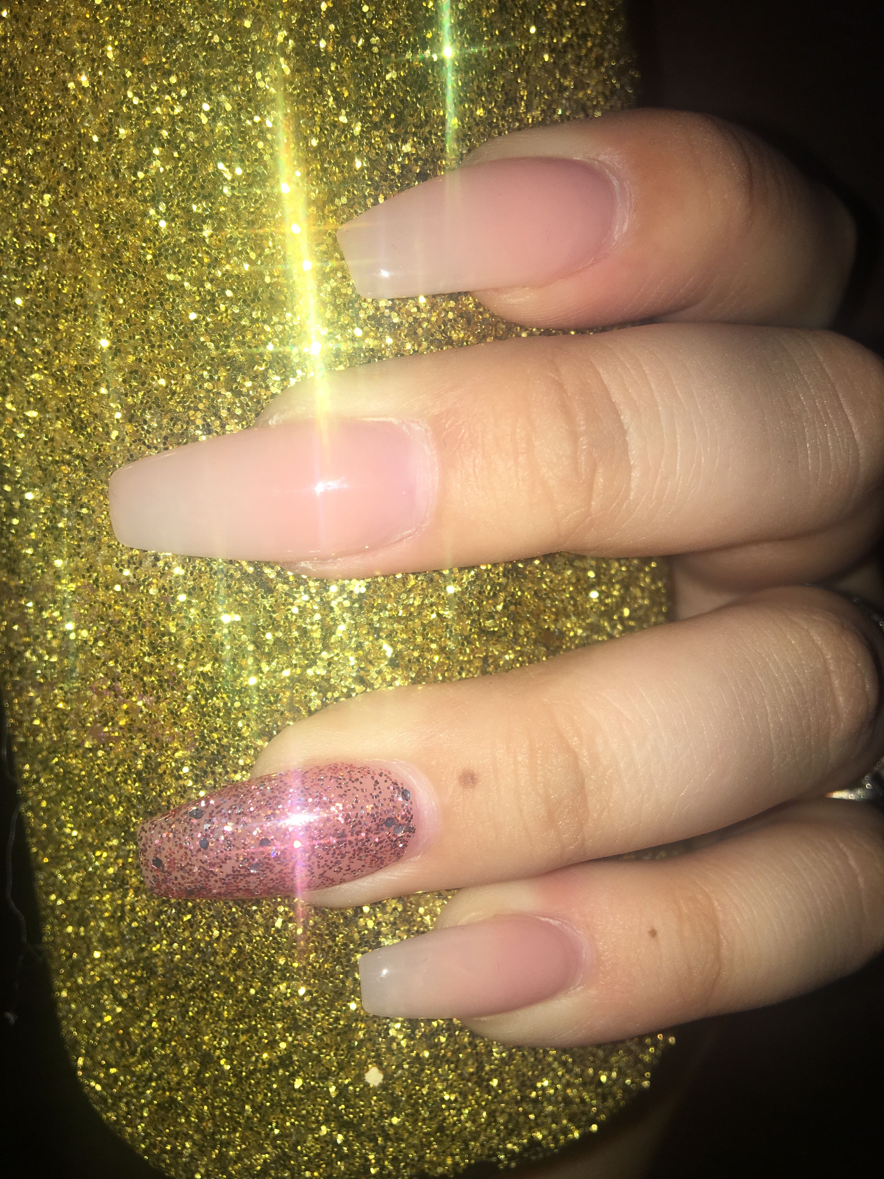 Natural color coffin nails with pink glitter on ring finger nail ...