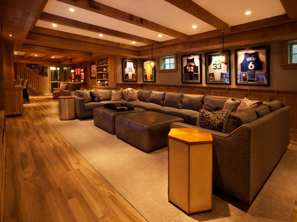 game room with wainscoting exposed beam hardwood floors carpet pendant light - Game Rooms