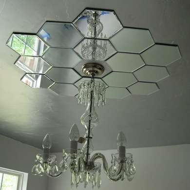 Mirrored Ceiling Tiles Around Hanging Light