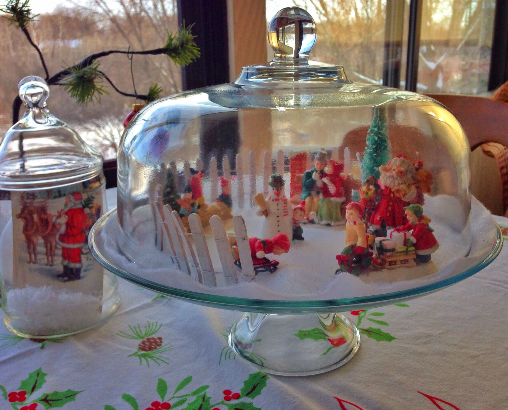 Christmas under glass covered cake plate and a christmas