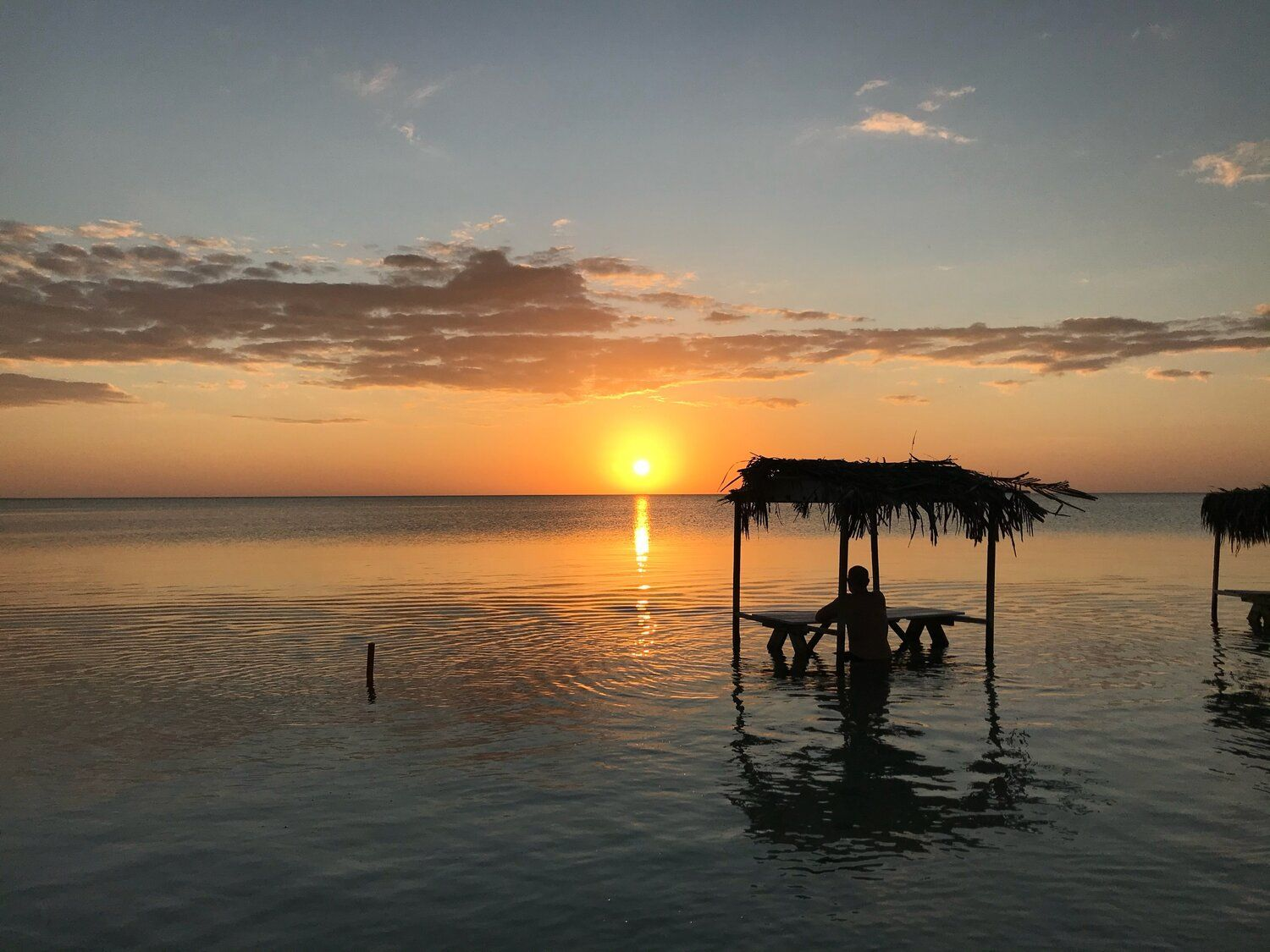 A sunset to remember at secret beach cabanas belize in
