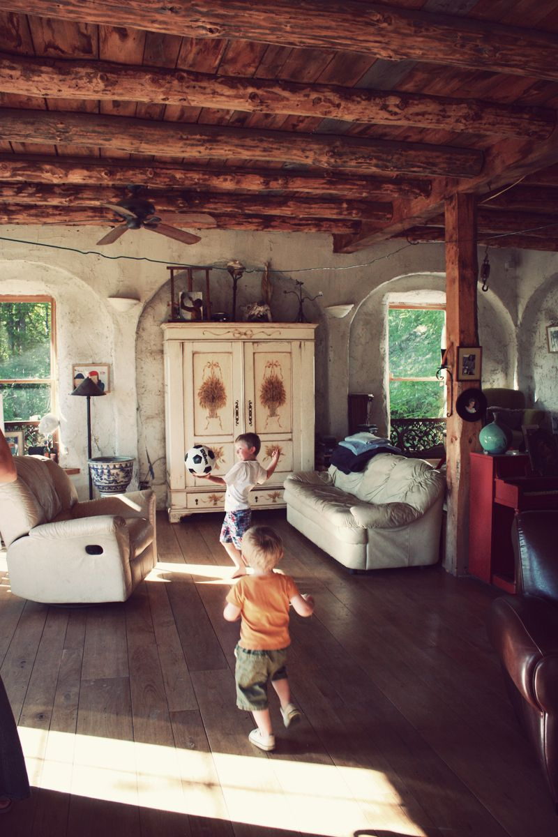 Strawbale buiding interior love the open space post and beam floorboards of different sizes arches great link whole house is awesome also rh pinterest