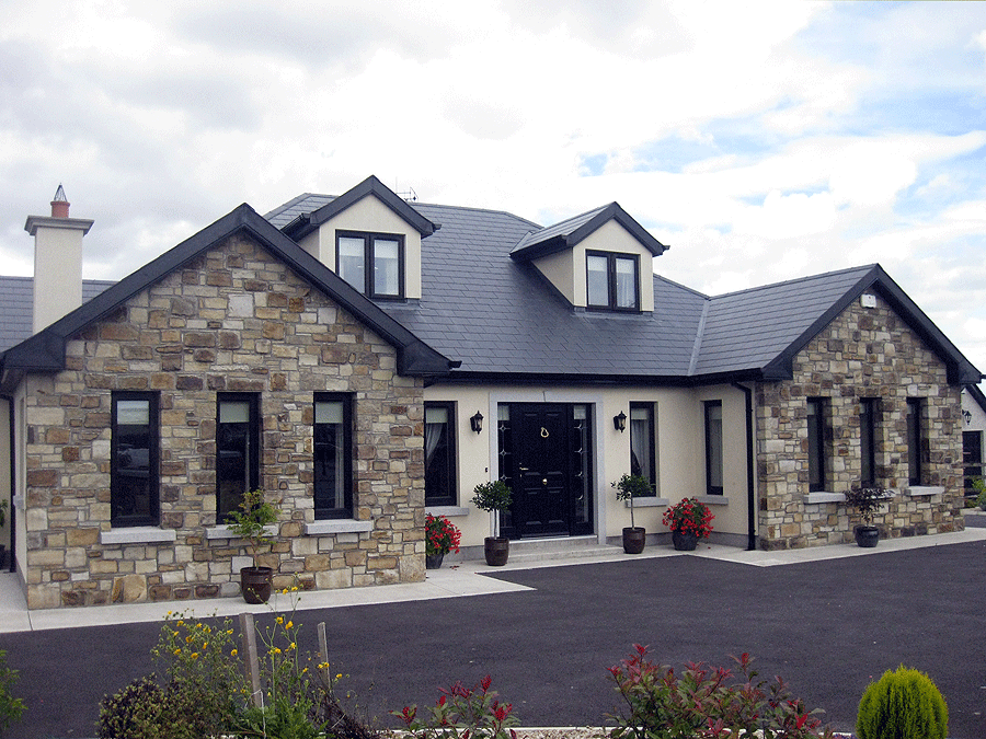 Stone porches around ireland light cream and sandstone for Dormer bungalow house plans ireland