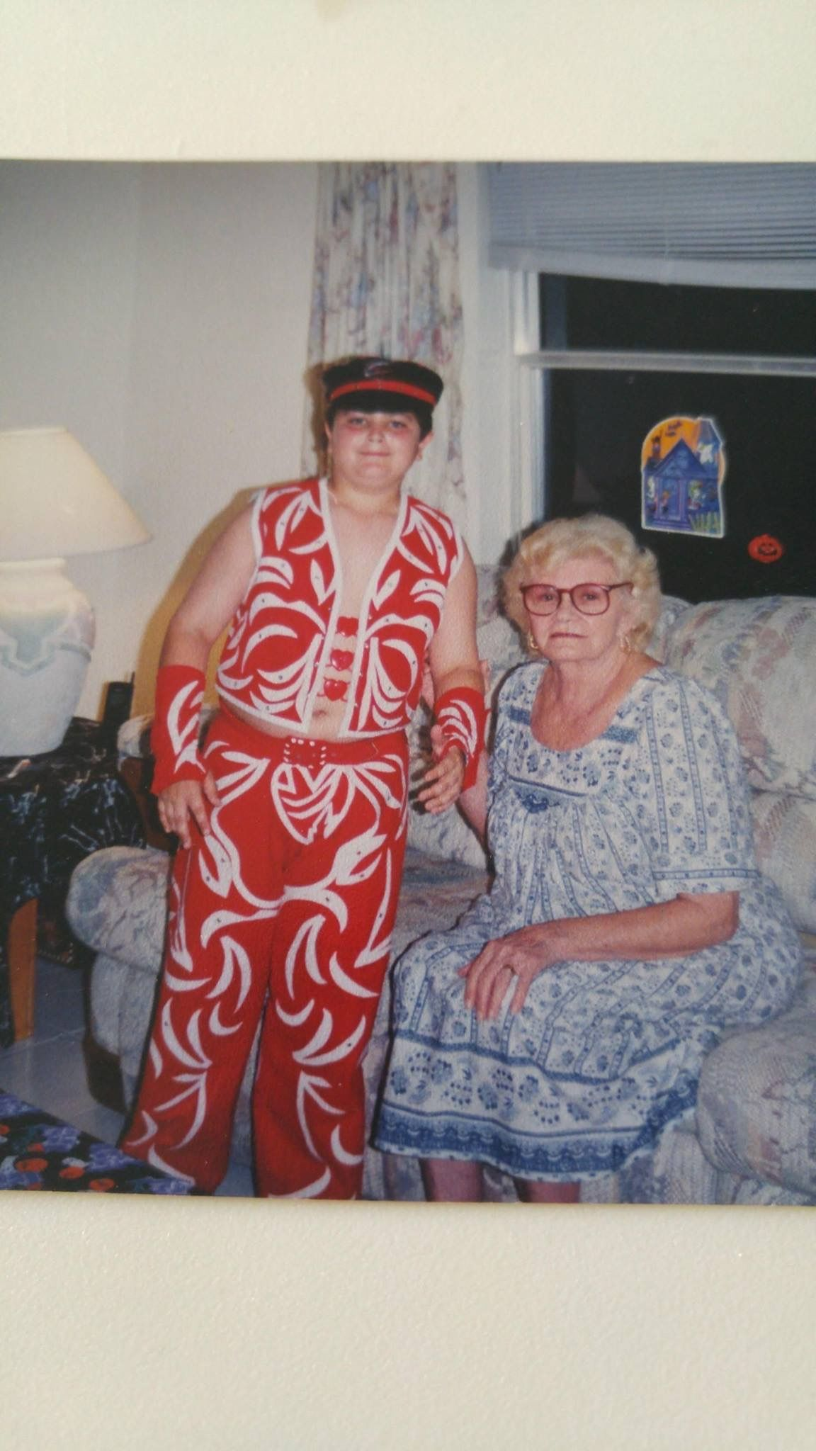 Child in Shawn Michaels halloween costume poses with grandmother ...