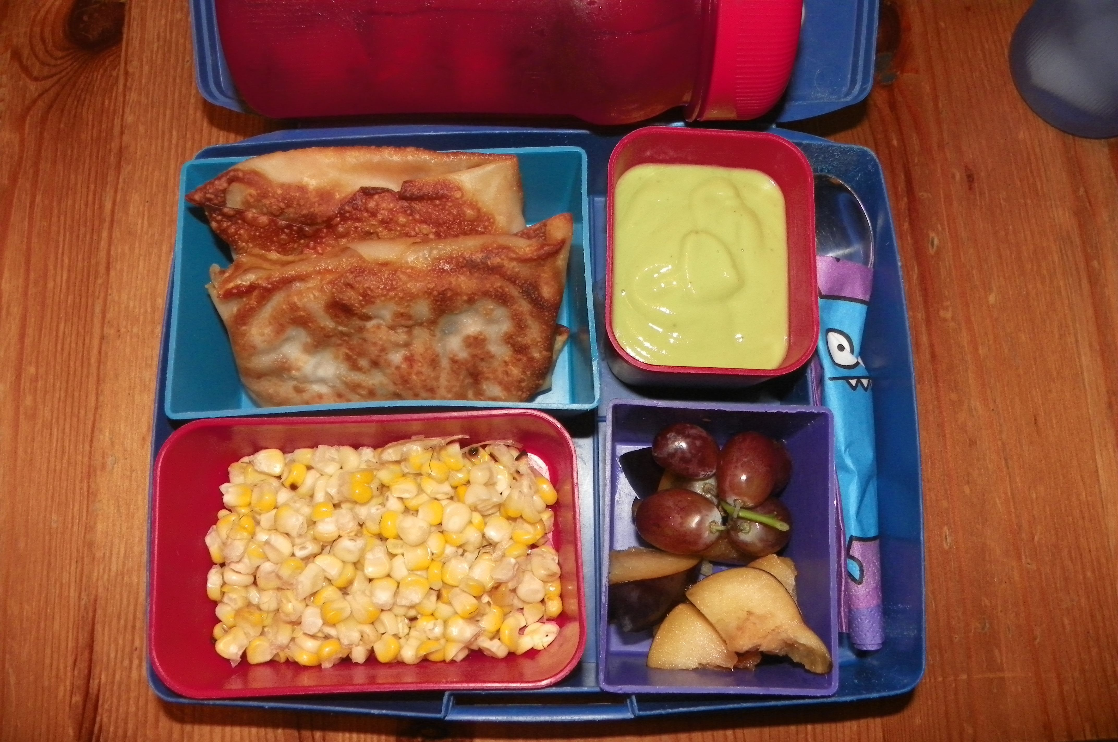 Southwest egg rolls w/ avocado dipping sauce, grilled corn, and grapes & plums
