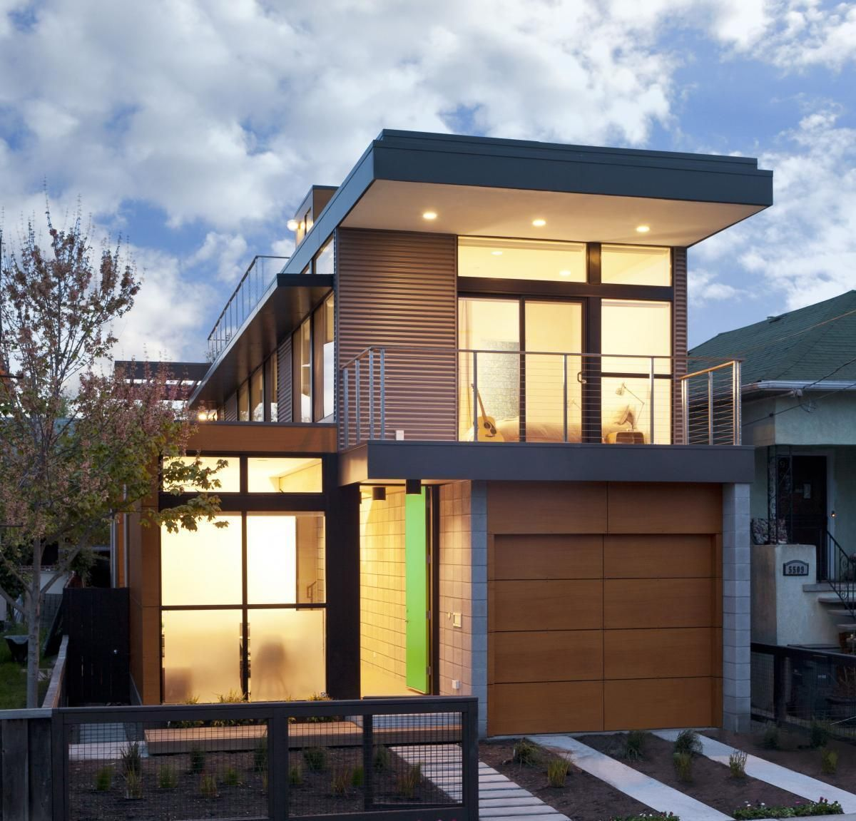 Small modern prefab house design with lighting idea in ceiling as well as wooden gate garage