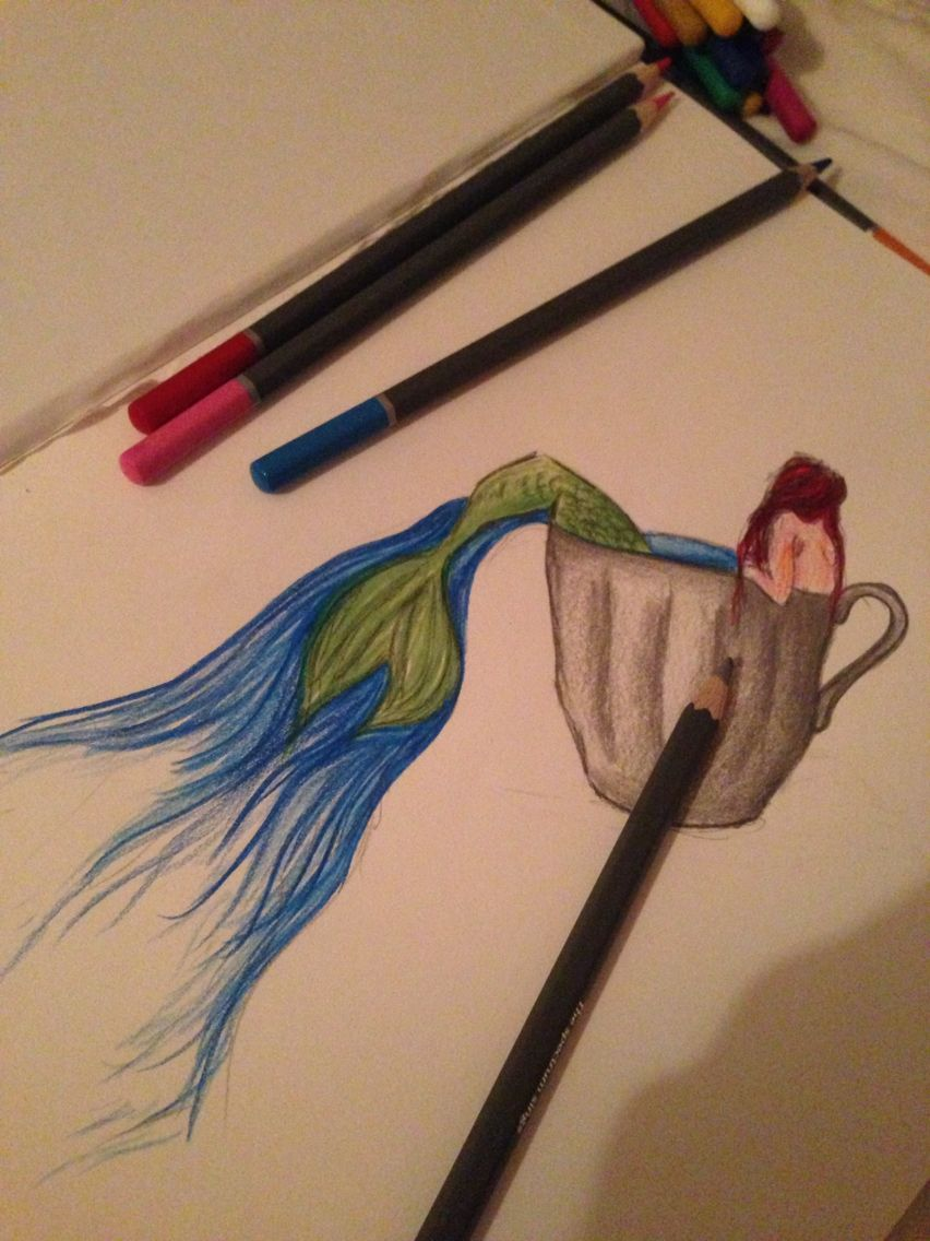 Mermaid being poured out of a tea cup