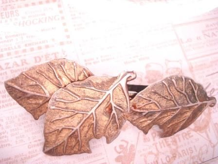 To add a touch of whimsy...vintage gold tone hair barrette  $10.00