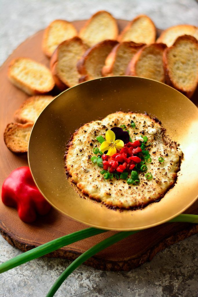 Charred Goat Cheese Queso Fundido with black truffles, honey, red bell peppers and spring onions - the most delicious, exotic dip for two!