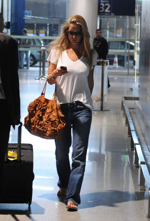Picture Of blue jeans, a white tee, an oversized brown