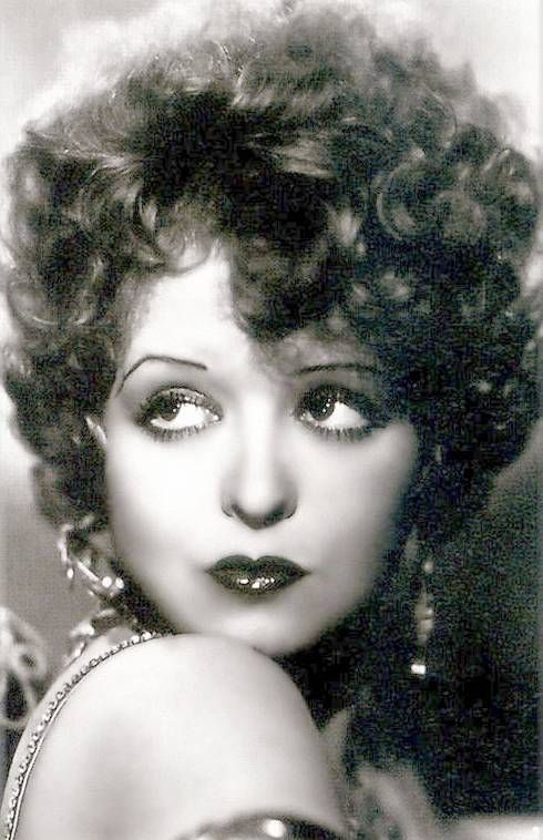 ARCADE CARD – MOVIE STAR – CLARA BOW – HEAVILY MADE UP WITH GOLD EARRINGS AND DRESS STRAP LOOKING OVER SHOULDER – A BEAUTIFUL BETTY BOOP