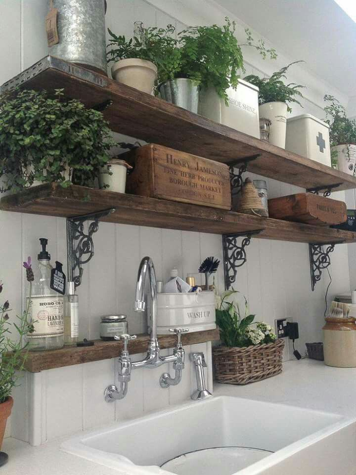 Dark Stained Rustic Wood Shelves With Decorative Metal Brackets For Mudroom