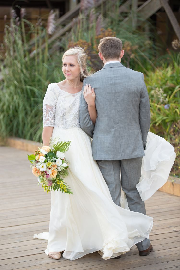 Modest wedding dress with elbow sleeves and a flowy skirt from alta