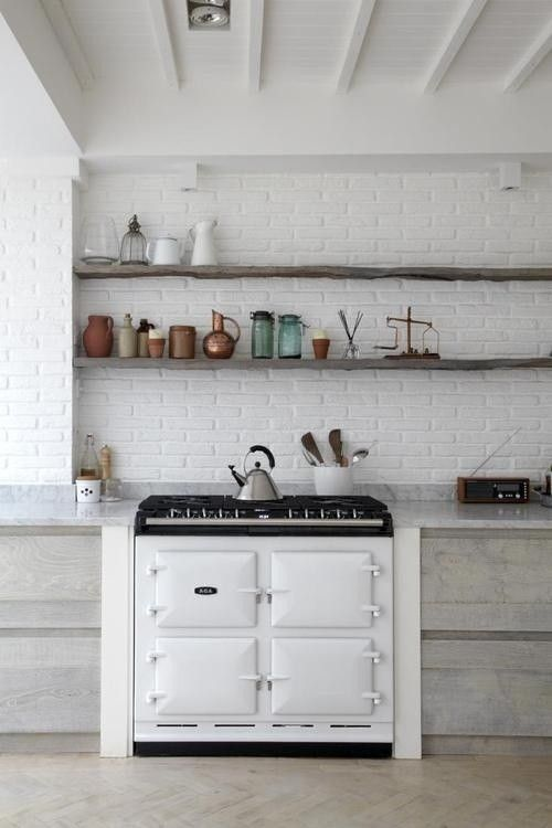 White Brick Walls And Rustic Wood Shelves Brick Wall Kitchen Brick Kitchen Scandi Kitchen