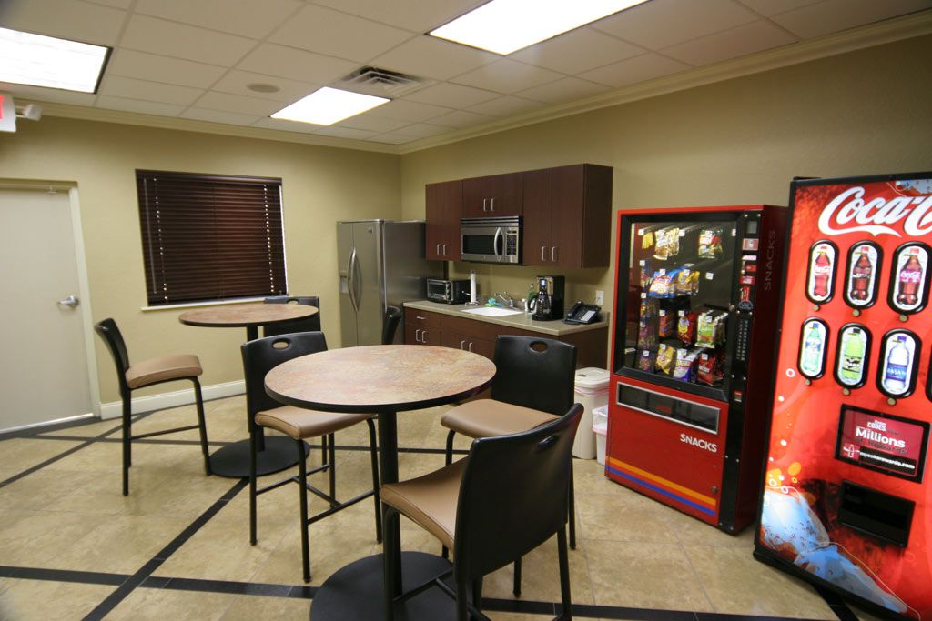 officesimple office break room ideas for small space with cream wall color and brown