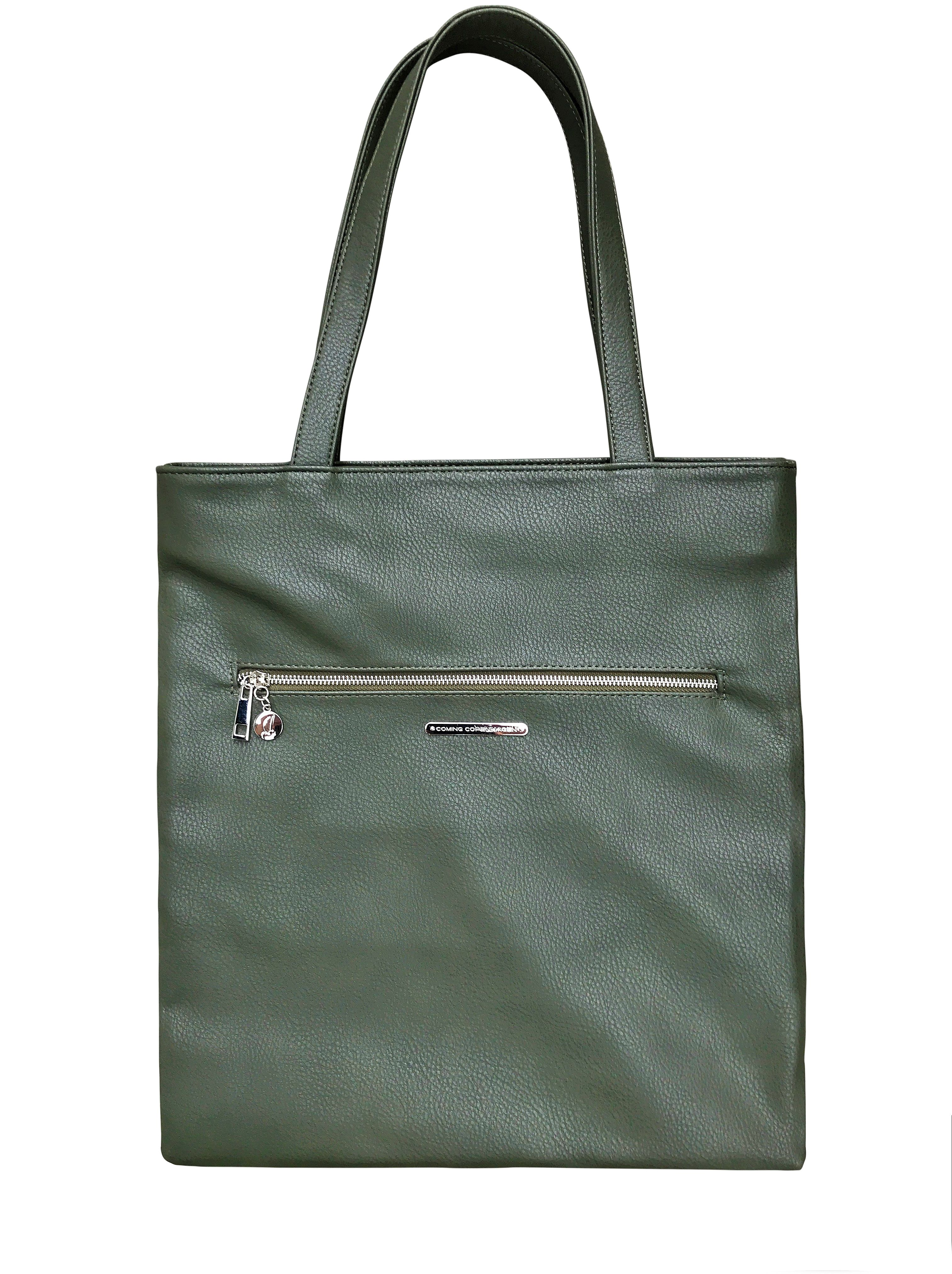 dbaec6e40bff An all-purpose tote fashioned from vegan leather. Features a voluminous  storage compartment
