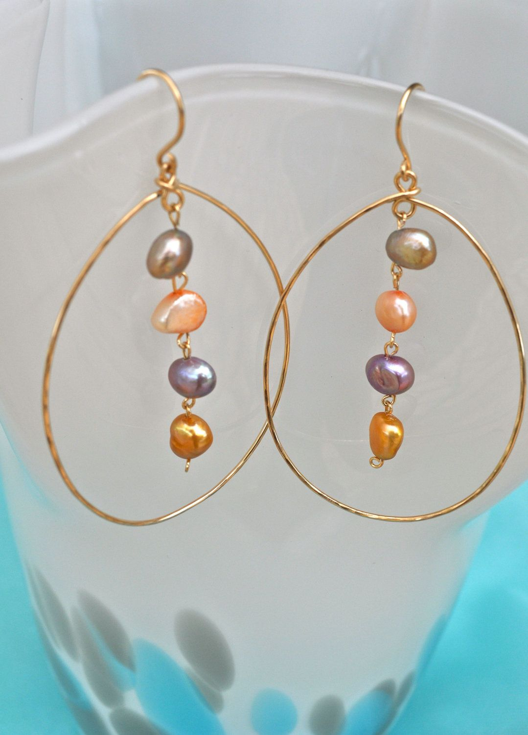 14K Gold Filled Handmade Hammered Tear Drop Hoop Earrings with cascading multi colored fresh pearls. $37.00, via Etsy.
