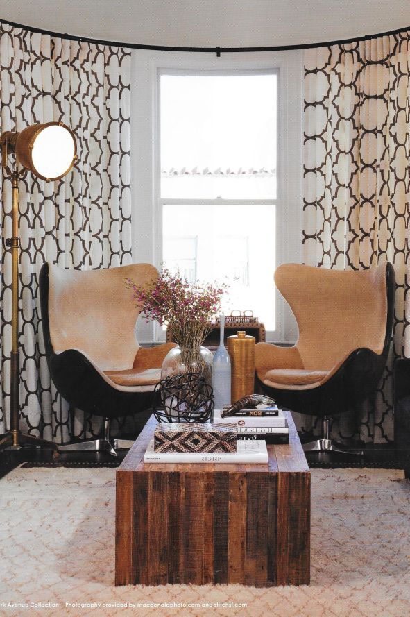 Stunning espresso and white geometric ripple fold drapes using Park Ave traverse rod by Brimar