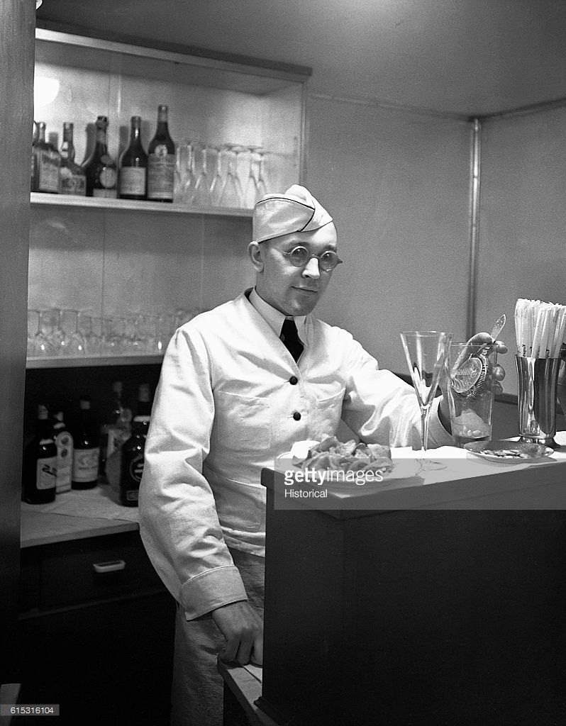 A bartender stands behind the bar of the Hindenburg