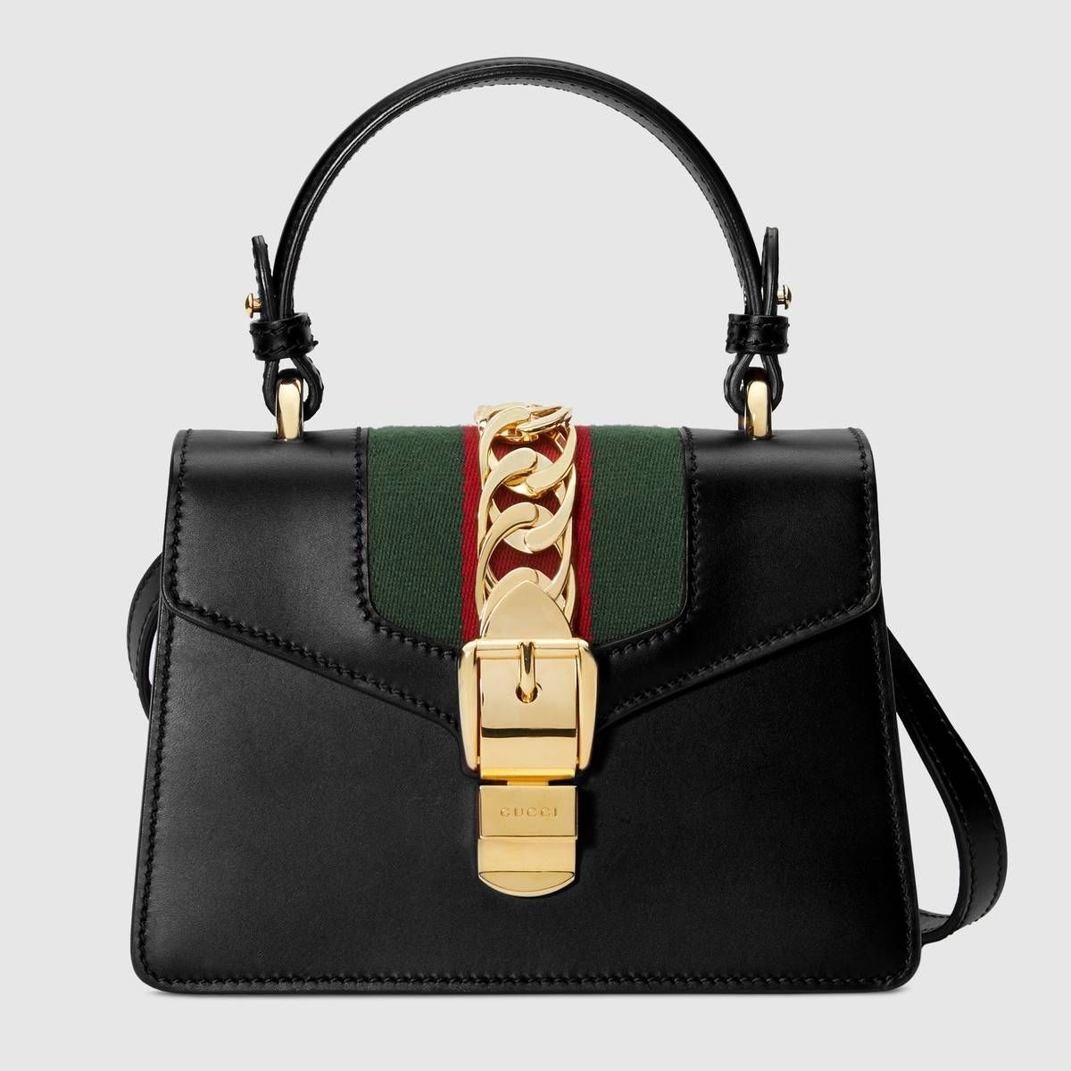 d65f5820c585 Shop the Sylvie leather mini bag by Gucci. The Sylvie mini bag in a top  handle shape with nylon Web embedded under the fabric and decorated with a  gold ...
