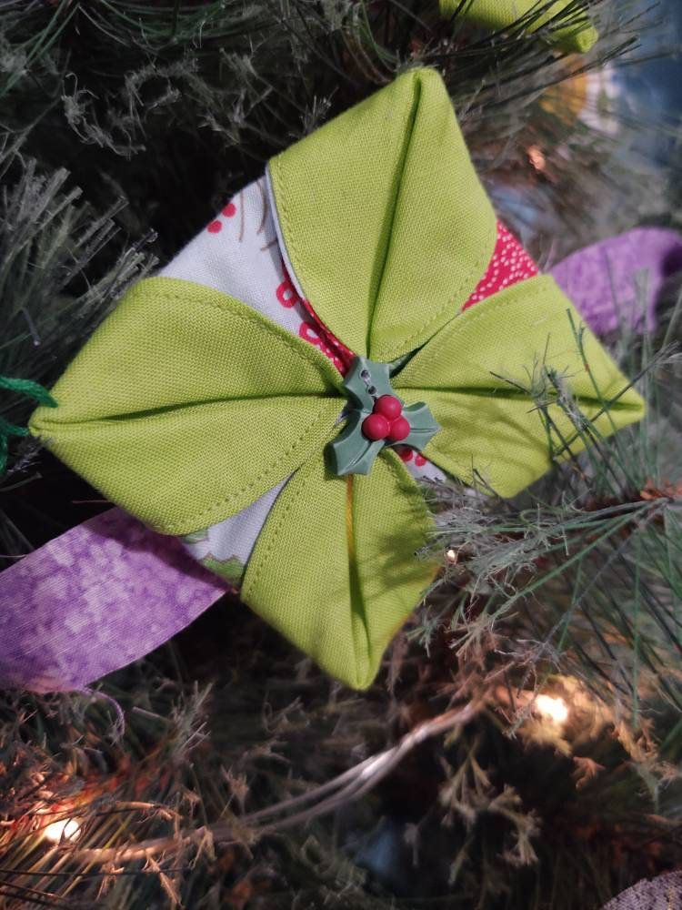 Photo of Weihnachtsorigami-Ornamente.