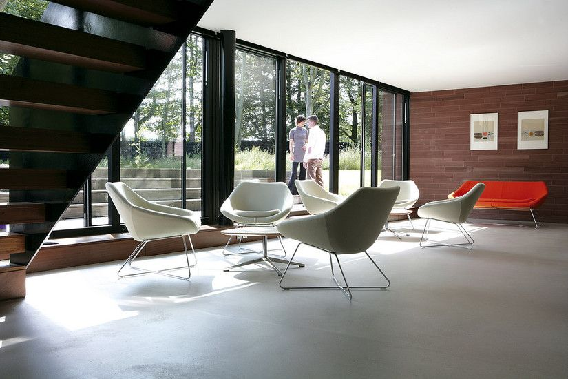 A642 Open Fully Upholstered Lounge Chair With Polished