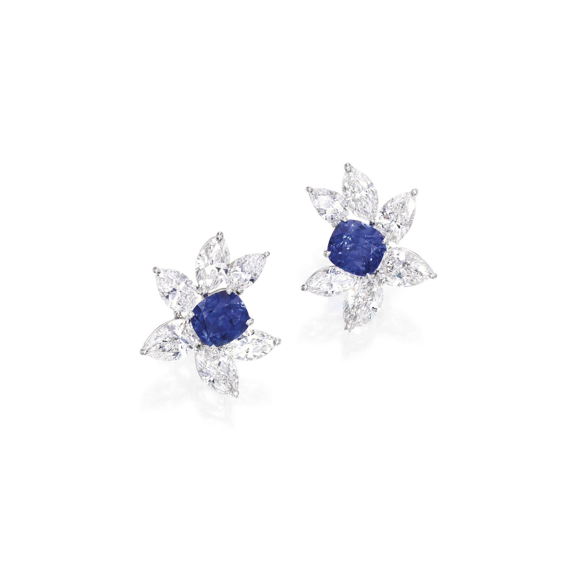 Pair Of Platinum Sapphire And Diamond Earrings Set With Two