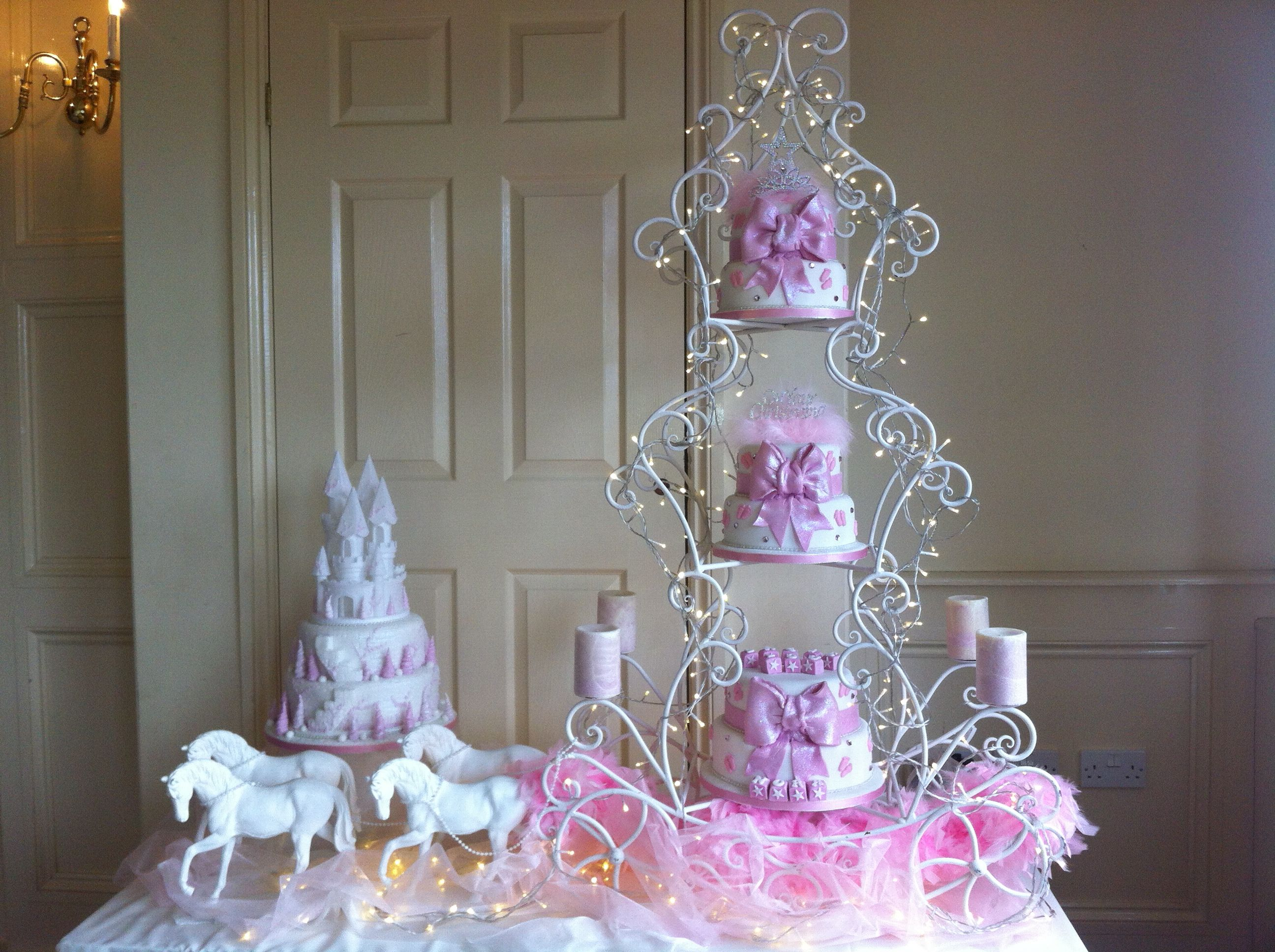 Huge 8 tier pink christening cake on our unique horse and carriage cake stand!